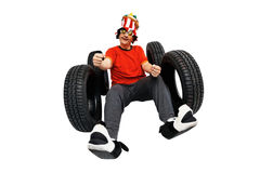 Crazy and funny driver with new tires. Isolated on white background royalty free stock image