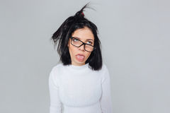 Crazy funny girl shows tongue. Crazy funny brunette young girl shows tongue, isolated on white background Stock Image