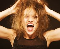Crazy funny goofy girl with messed hair close up Stock Photography