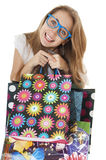 Crazy funny young girl with shopping gift bags wearing glasses. Royalty Free Stock Photo