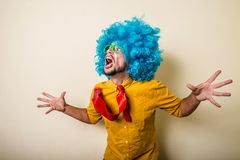Crazy funny young man with blue wig Stock Images