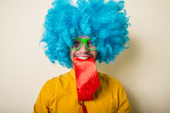 Crazy funny young man with blue wig Royalty Free Stock Photo