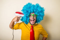 Crazy funny young man with blue wig Royalty Free Stock Photos