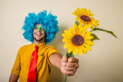 Crazy funny young man with blue wig. On white background Royalty Free Stock Photo