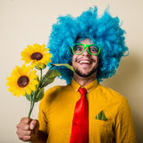Crazy funny young man with blue wig Stock Photos