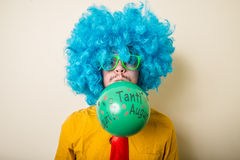 Crazy funny young man with blue wig Royalty Free Stock Image