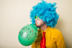 Crazy funny young man with blue wig Stock Photo