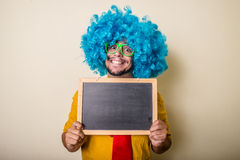 Crazy funny young man with blue wig Royalty Free Stock Images