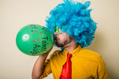 Crazy funny young man with blue wig Stock Image