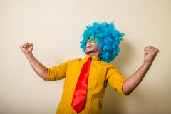 Crazy funny young man with blue wig. On white background Stock Photography