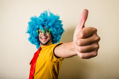 Crazy funny young man with blue wig. On white background Royalty Free Stock Photography