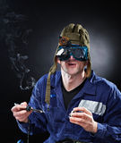 Crazy genious witth soldering iron Stock Images