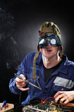 Crazy genious witth soldering iron Stock Image