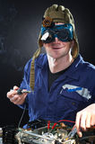 Crazy genius witth soldering iron Royalty Free Stock Photography