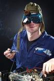 Crazy genius witth soldering iron. Crazy funny genius with soldering iron Royalty Free Stock Photography