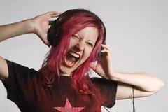 Crazy girl. Model capture, crazy girl listening music, outdoor capture with studio flash Stock Image