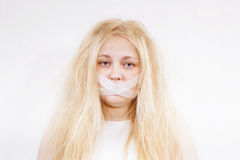 Crazy girl. With her ​​mouth sealed Stock Photography