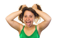 Crazy girl. Funny image of a crazy girl grabbing her hair and showing her tongue . White background Royalty Free Stock Images