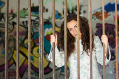 Crazy girl behind the bars Stock Photo