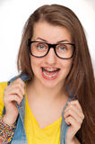 Crazy girl with braces wearing geek glasses Royalty Free Stock Image