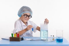 Crazy girl chemist puts experience Royalty Free Stock Images