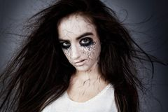 Crazy girl with disheveled hair, black eyes and veins. concept of halloween and day of the dead. Portrait of a crazy girl with disheveled hair, black eyes and royalty free stock photos