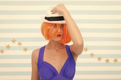Crazy girl in hat. fashion woman with orange hair. Glamour fashion model. Stylish girl with crazy look. Beauty and stock images
