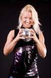 Crazy girl holding sphere Stock Photo