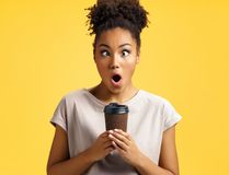 Crazy girl holds cup of hot coffee. royalty free stock photo