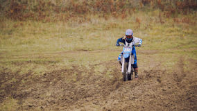 Crazy girl mx biker - motocross racer on dirt bike at sport track Stock Photo