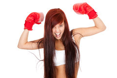 Crazy girl with red boxing gloves. White background Royalty Free Stock Photo