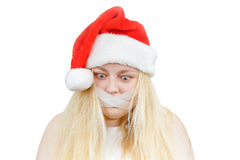 Crazy girl in a Santa hat Stock Images
