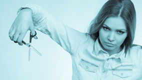 Crazy girl with scissors. Hairdresser in action. Stock Image
