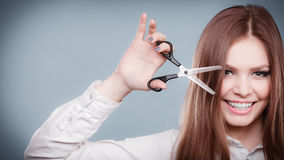 Crazy girl with scissors. Hairdresser in action. Royalty Free Stock Photo
