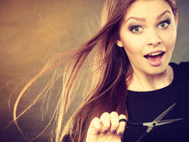 Crazy girl with scissors. Hairdresser in action. Royalty Free Stock Photos