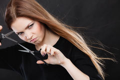 Crazy girl with scissors. Hairdresser in action. Stock Photography