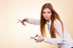 Crazy girl with scissors. Hairdresser in action. Royalty Free Stock Image