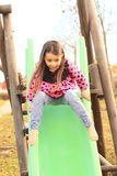 Crazy girl on a slide Royalty Free Stock Photo