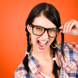 Crazy girl wear nerd glasses shouting. On orange background Stock Photography