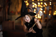 Crazy Girl witch with  broom . childhood Halloween Royalty Free Stock Photos