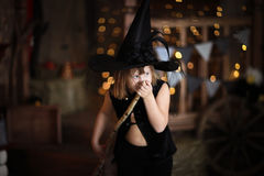 Crazy Girl witch with  broom . childhood Halloween Stock Photo