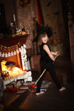 Crazy Girl witch with  broom . childhood Halloween Stock Photography