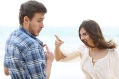 Crazy girlfriend scolding her boyfriend stock photo