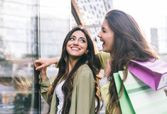 Crazy girls making shopping Royalty Free Stock Images