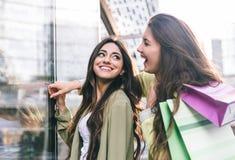 Crazy girls making shopping Royalty Free Stock Images