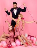 Crazy girls and man on pink. Halloween. Creative idea. Love triangle. retro girls and master in party balloons. vintage. Crazy girls and men on pink. Halloween stock photos