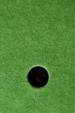 Crazy golf course hole with artificial grass. Stock Images