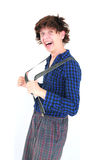 Crazy goofy guy with funny hair and clothes. Crazy nerdy man with funny hair and clothes puling his braces Royalty Free Stock Image