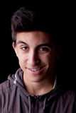Crazy Grin. Young man portrait with crazy grin. Black background, studio shot Stock Images