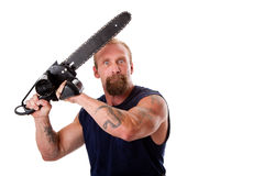 Crazy guy with chainsaw. Crazy Caucasian man with tattoos and chainsaw above his head with strong expression in eyes, isolated stock images